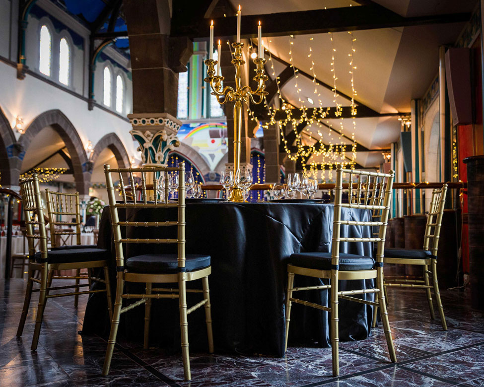 Nero Verona table linen, Gold Candelabra and Gold Chiavari Chairs with Noir Taffeta cushioned seat pads