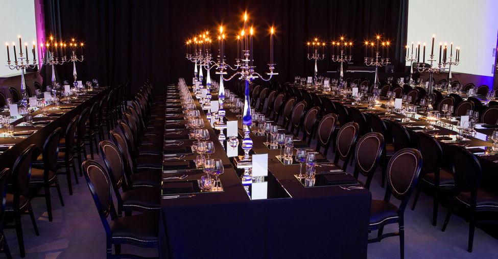 Black Essential table linen and napkins, Silver Square Base Candelabras, Smoke Glasses and Black French Chairs