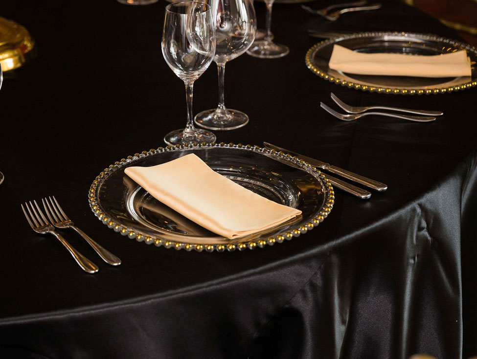 Nero Verona table linen, Gold Beaded charger plate paired with Golden Verona napkin