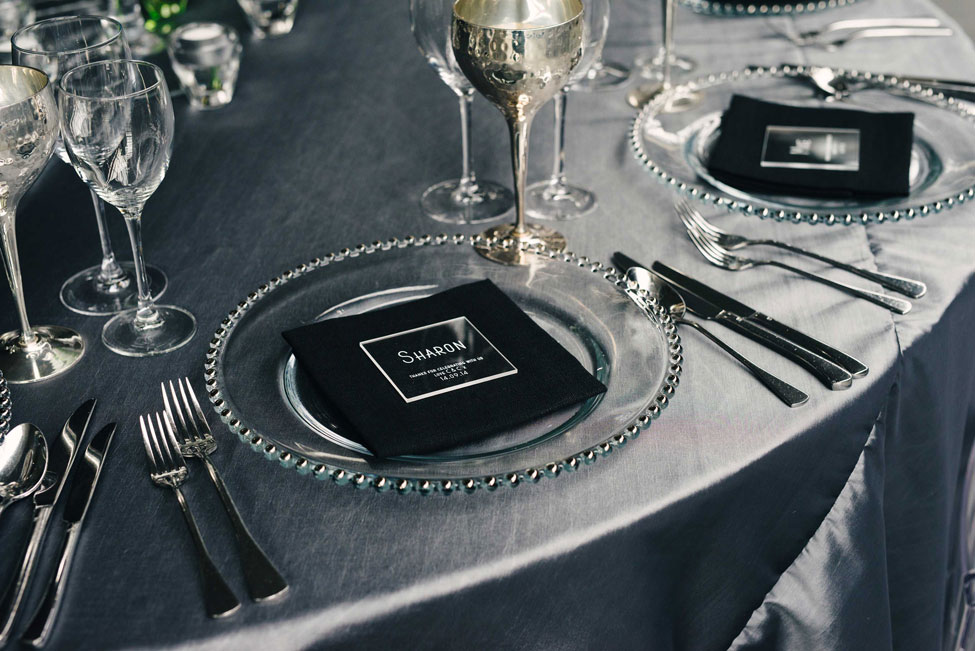 Super Silver table linen, Silver Beaded charger plate paired with Black Essential napkin and Pewter Goblets