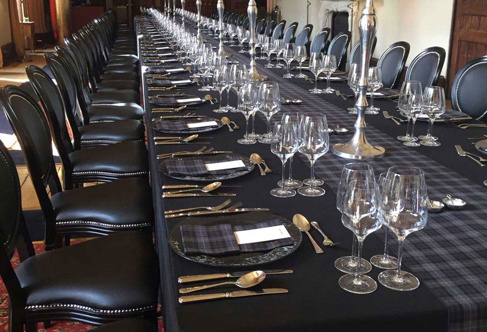 Arran Tartan runners, Smoke Grey charger plate with Arran Tartan napkins, Black Essential table linen and Black French Chairs