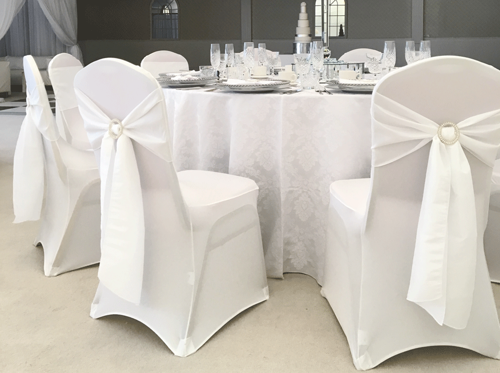 Snow White Vintage Damask table linen, White Italian Stretch Chair Covers paired with Cloudy White taffeta seat ties styled with diamante buckles