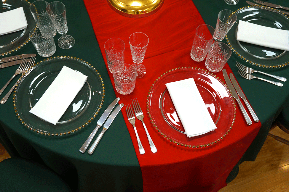 Green Essential table linen, Red Berry Taffeta runner, Cut Crystal glasses, Gold Beaded charger plates with White Essential napkins