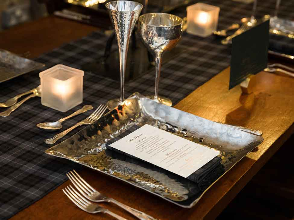 Arran Tartan runners and napkins, Pewter charger plate, goblet and flute.
