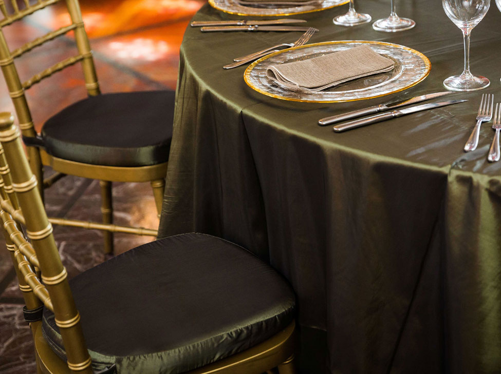 Woodland Taffeta table linen, Gold Trim charger plate with Malted Wheat napkin, Gold Chiavari Chairs with Woodland Taffeta seat pad