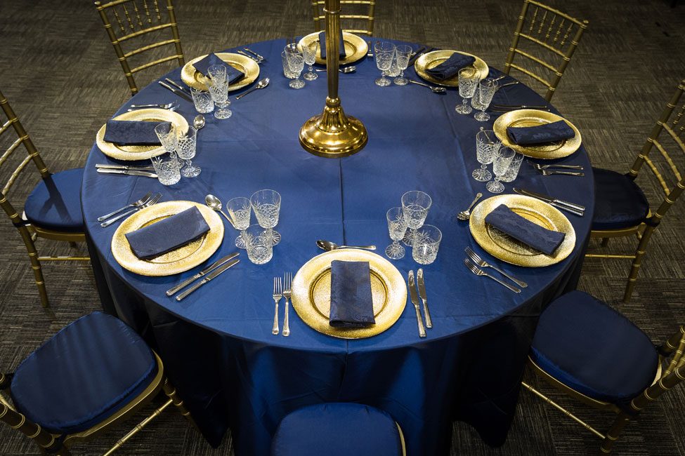 Midnight Blue Taffeta table linen, Cut Crystal glasses, French Navy Vintage Damask napkins paired with Gold Starburst charger plates, Gold Chiavari Chairs with Midnight Blue Taffeta pads at 200 SVS, Image courtesy of First Light Photography