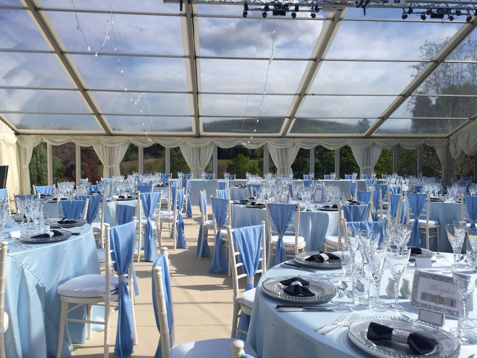 Powder Blue table linen, Silver charger plates paired with Navy Essential bowtie napkins, Ivory Chiavari Chairs with White Essential seat pads and Powder Blue Valentina weaves at Ballogie House