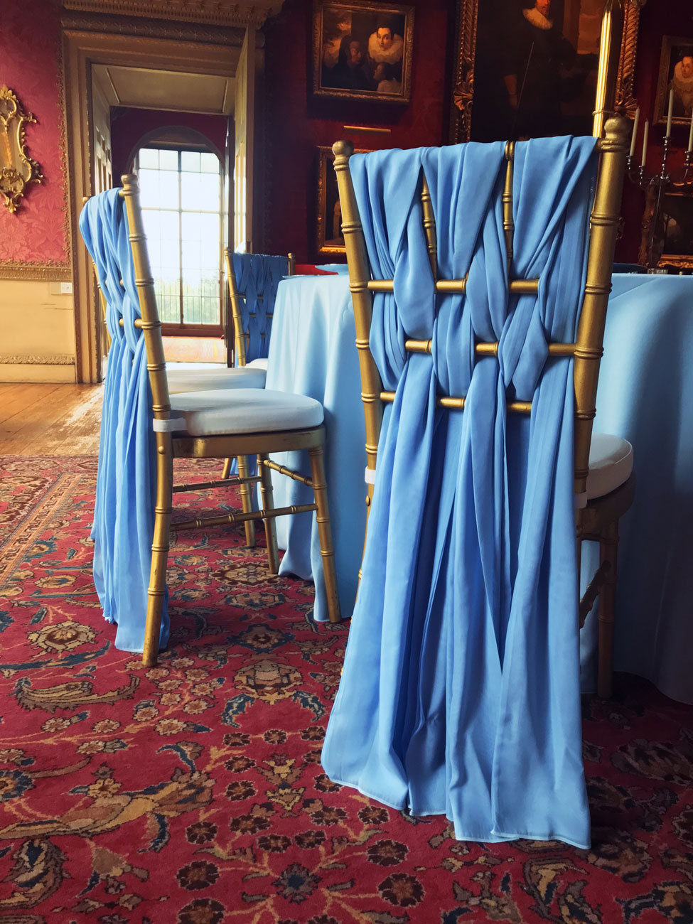 Powder Blue Verona table linen, Gold Chiavari Chairs with White Essential seat pads and Powder Blue Santina Weaves at Hopetoun House