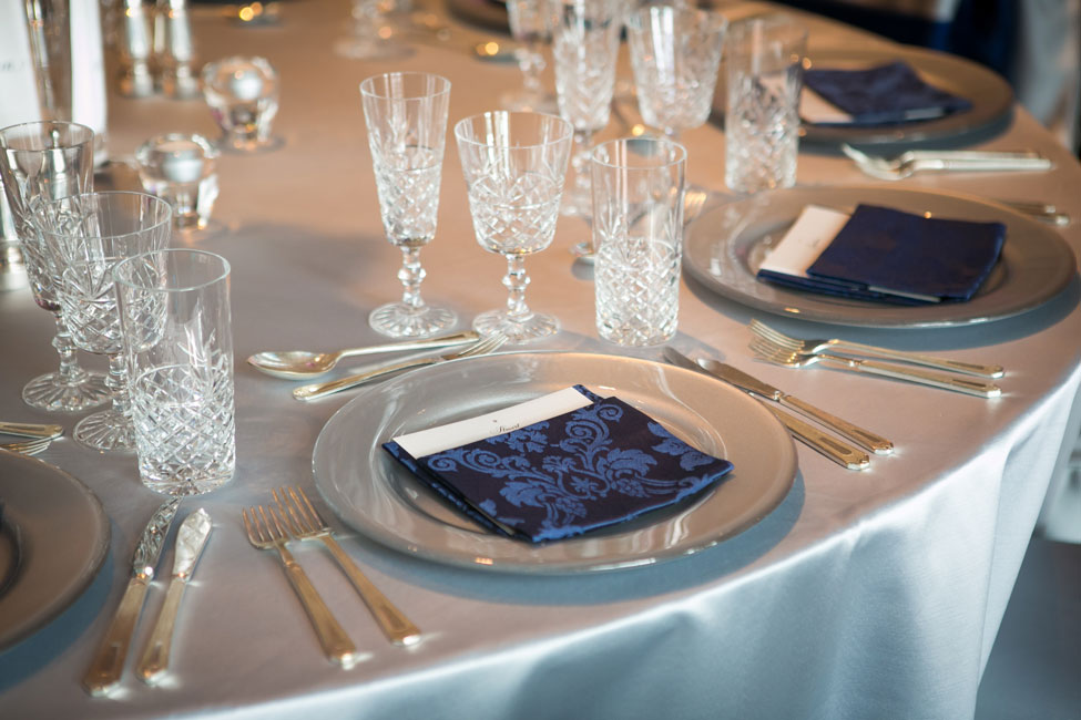 French Navy Vintage Damask napkins paired with Silver Milano table linen and Cut Crystal glasses at Trump Turnberry Resort