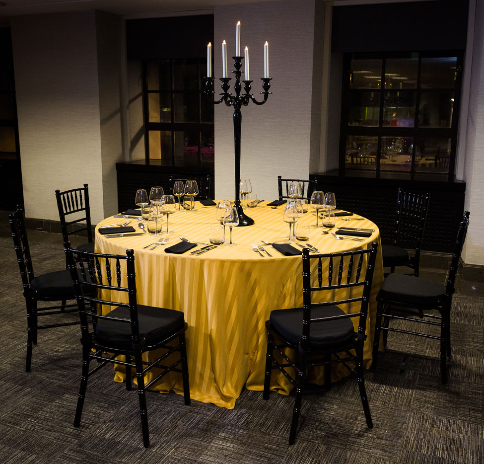 Styling featuring Gold Chic table linen, Black Essential napkins, Smoke Grey glasses, Black Gloss Candelabra and Black Chiavari Chairs with Black Essential seat pads