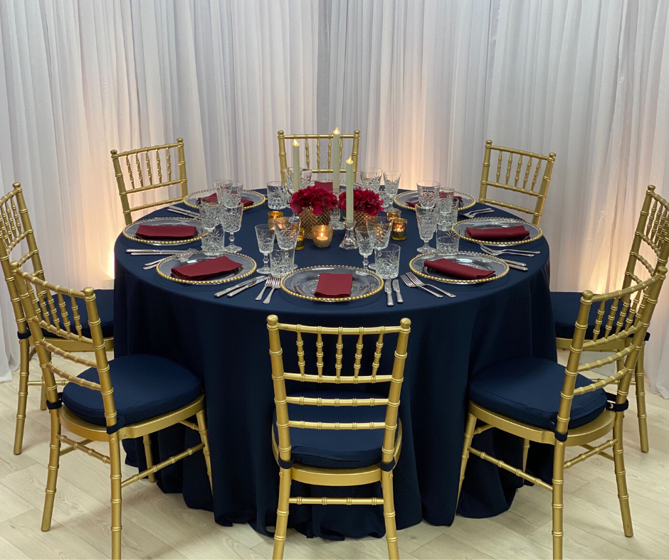 Navy Essential tablecloth with Gold Chiavaris w/matching Navy Essential cushioned pads
