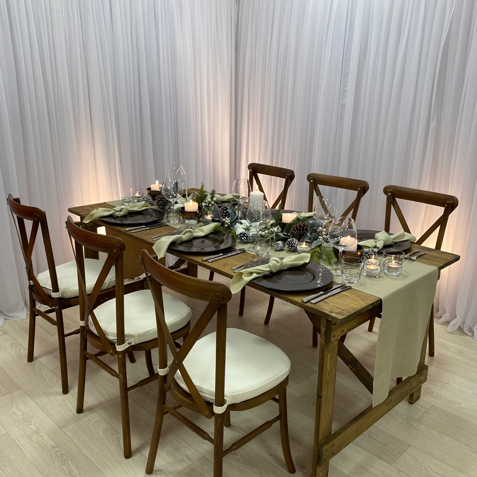 Styling features: Crossback chairs w/cream Essential pads, caramello Gelato runner & napkins, brown chargers & Copper detail tumblers & Riedel glasses.