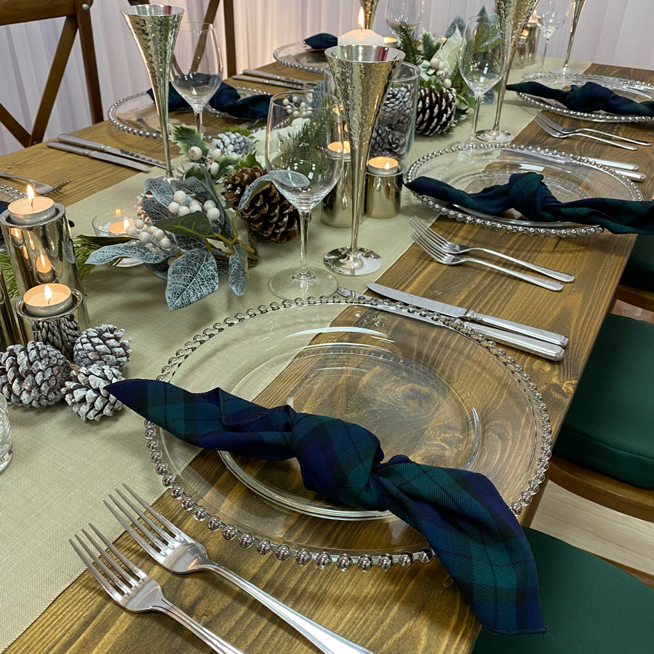Styling features: Crossback chairs w/green Essential pads, caramello Gelato runner & Blackwatch tartan napkins, silver Beaded chargers & Pewter chalice.